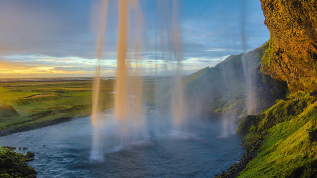 Waterfall over a cliff at sunset